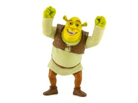 A green ogre named Shrek holding his hands above his head