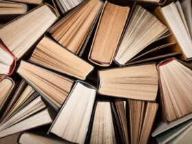 A pile of books stacked sporadically on each other