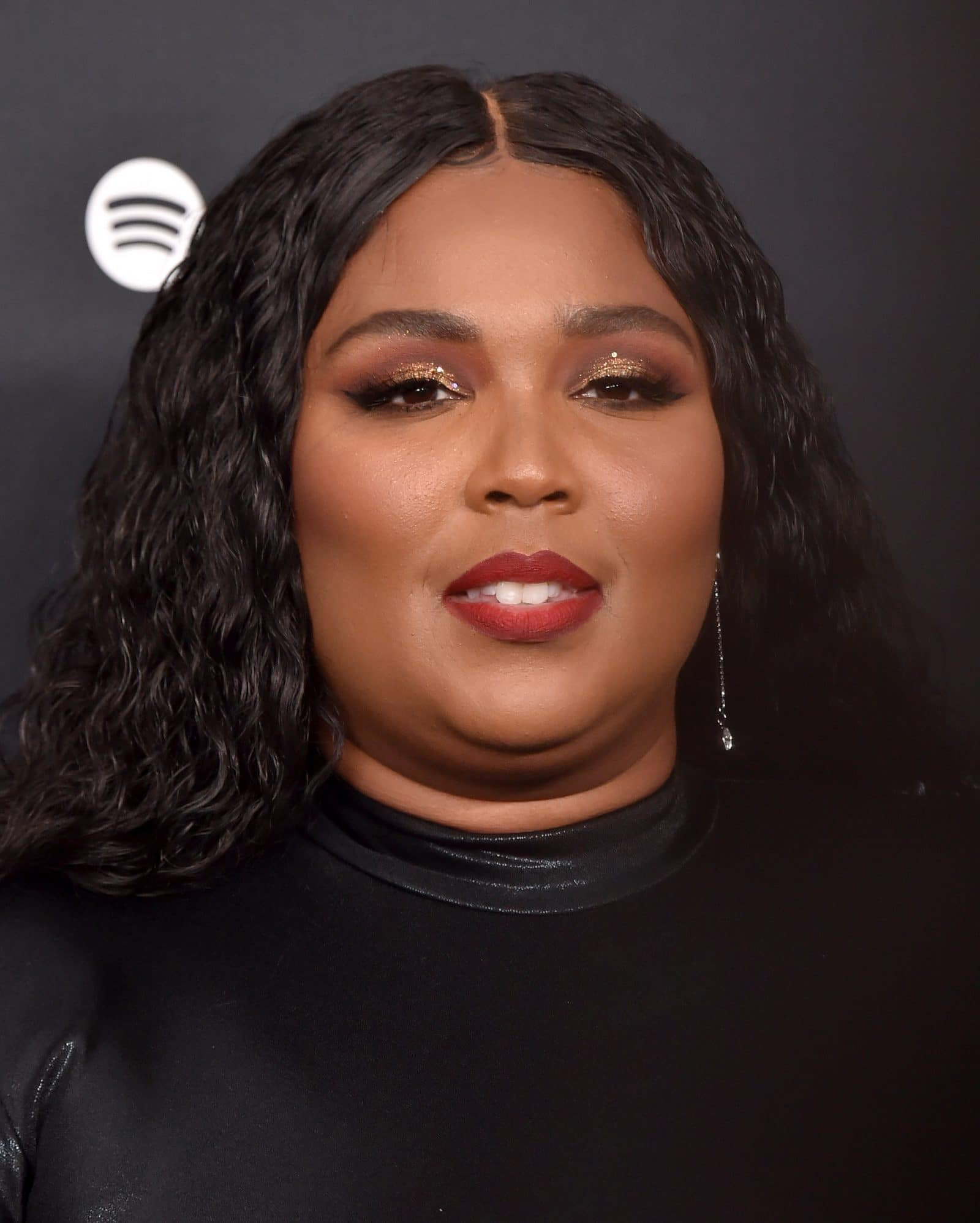 Lizzo in a black dress